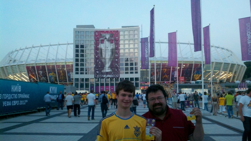 Alec, sporting a Ukraine jersey, with his dad at the Euro Cup in Kiev, Ukraine.